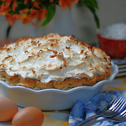 Side view of Old fashioned Coconut Pie with a high browned meringue