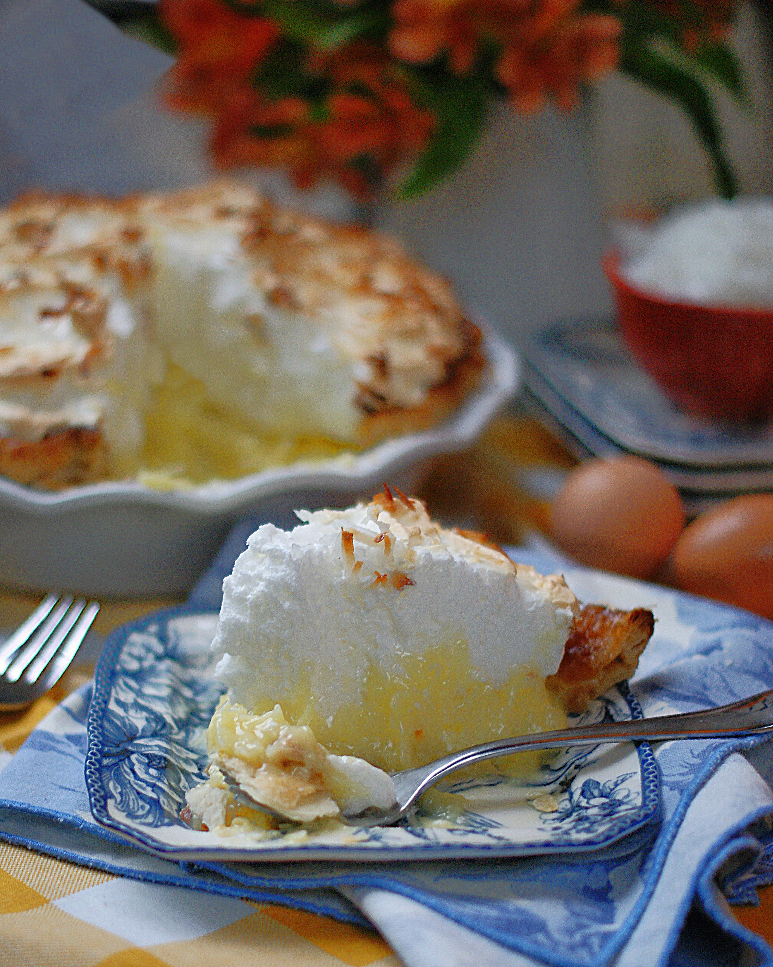A slice of old fashioned coconut pie with meringue