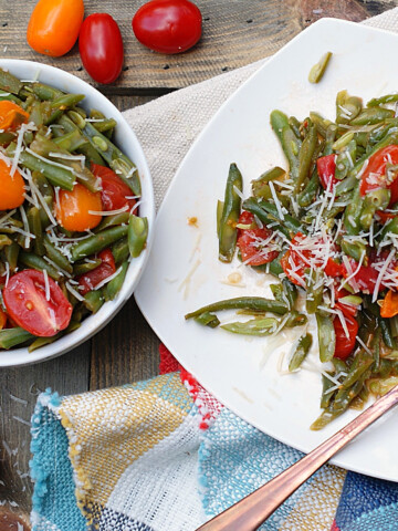 Finished Warm Italian Green Bean Salad on a plate and in a bowl.