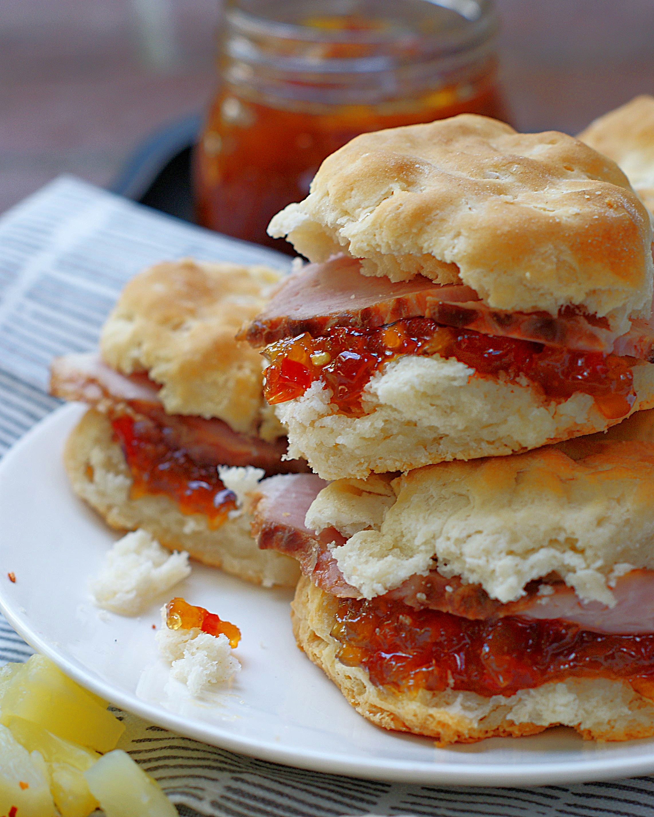 Biscuit sliders made with ham and pineapple red pepper jelly