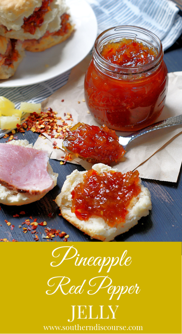 Pineapple Red Pepper jelly is an easy stove top recipe that is a quick set refrigerator jelly using cornstarch. It as a jam-like consistency and keeps in the fridge up to 3-4 weeks. Perfect over cream cheese as an appetizer, as a glaze on pork chops or on biscuits with ham. #southerndiscourse #pineapple #pineapplejelly #redpepperjelly #freeezerjam #appetizer