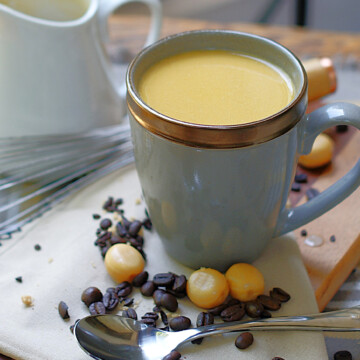 A steaming cup of coffee with Butterscotch Coffee Creamer.
