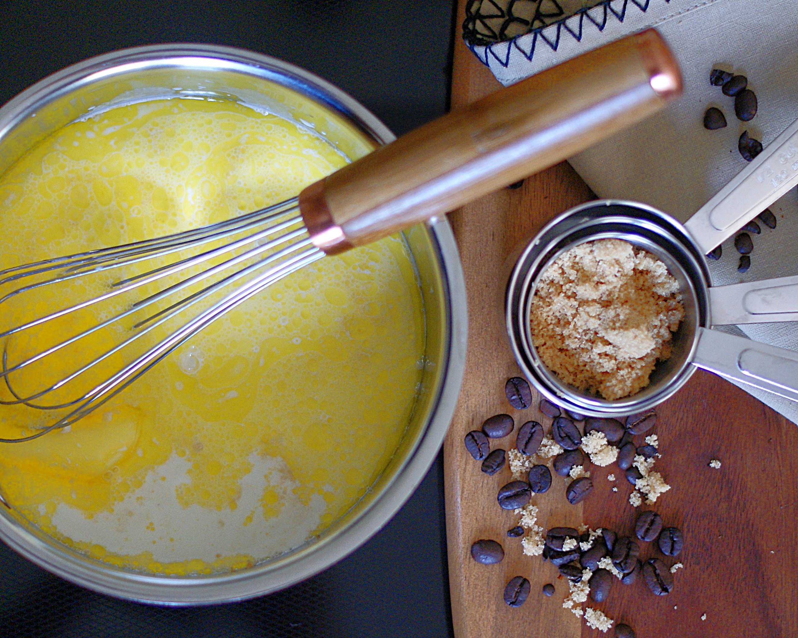 Butter and cream in a sauce pan with a whisk.