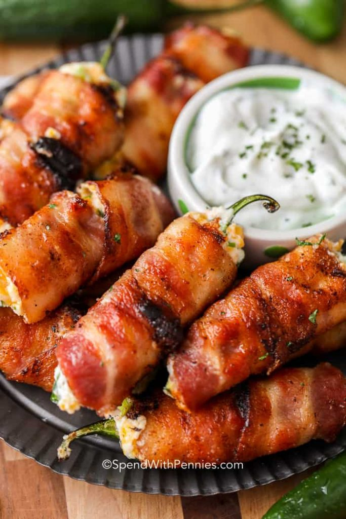 Bacon wrapped jalapeno poppers done on the grill.