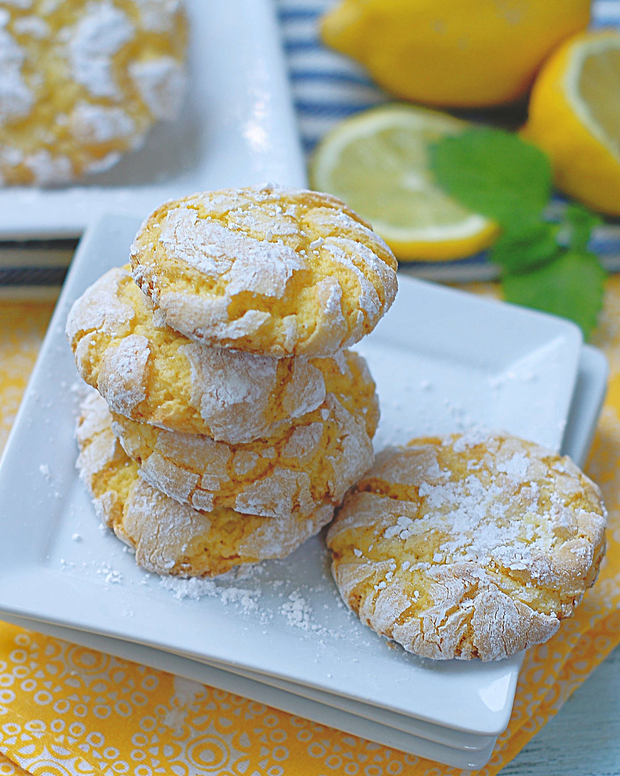 A stack of lemon crinkle cookies with powdered sugar are tart and sweet.