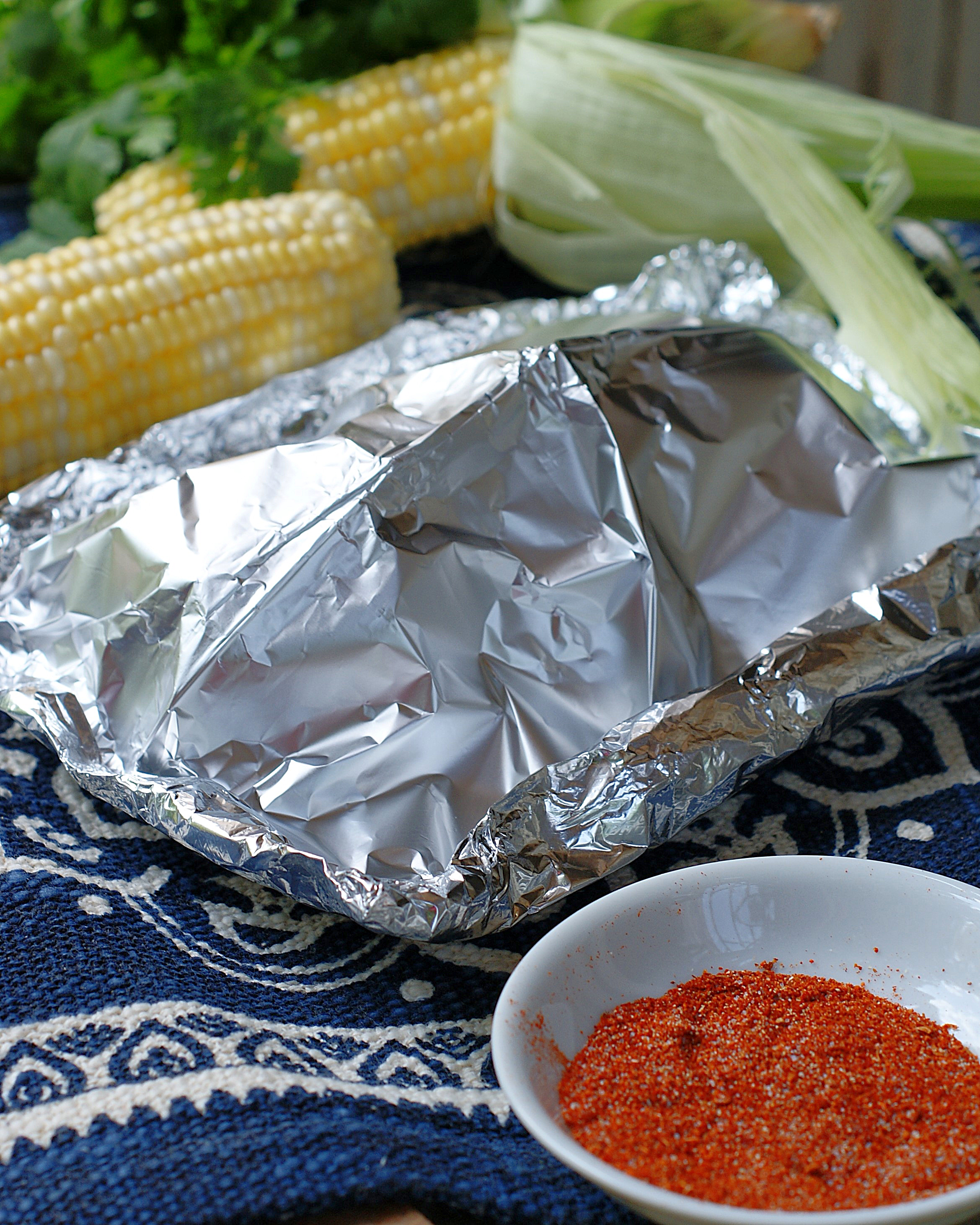 A tented foil packet for baking or grilling Mexican Street Corn.