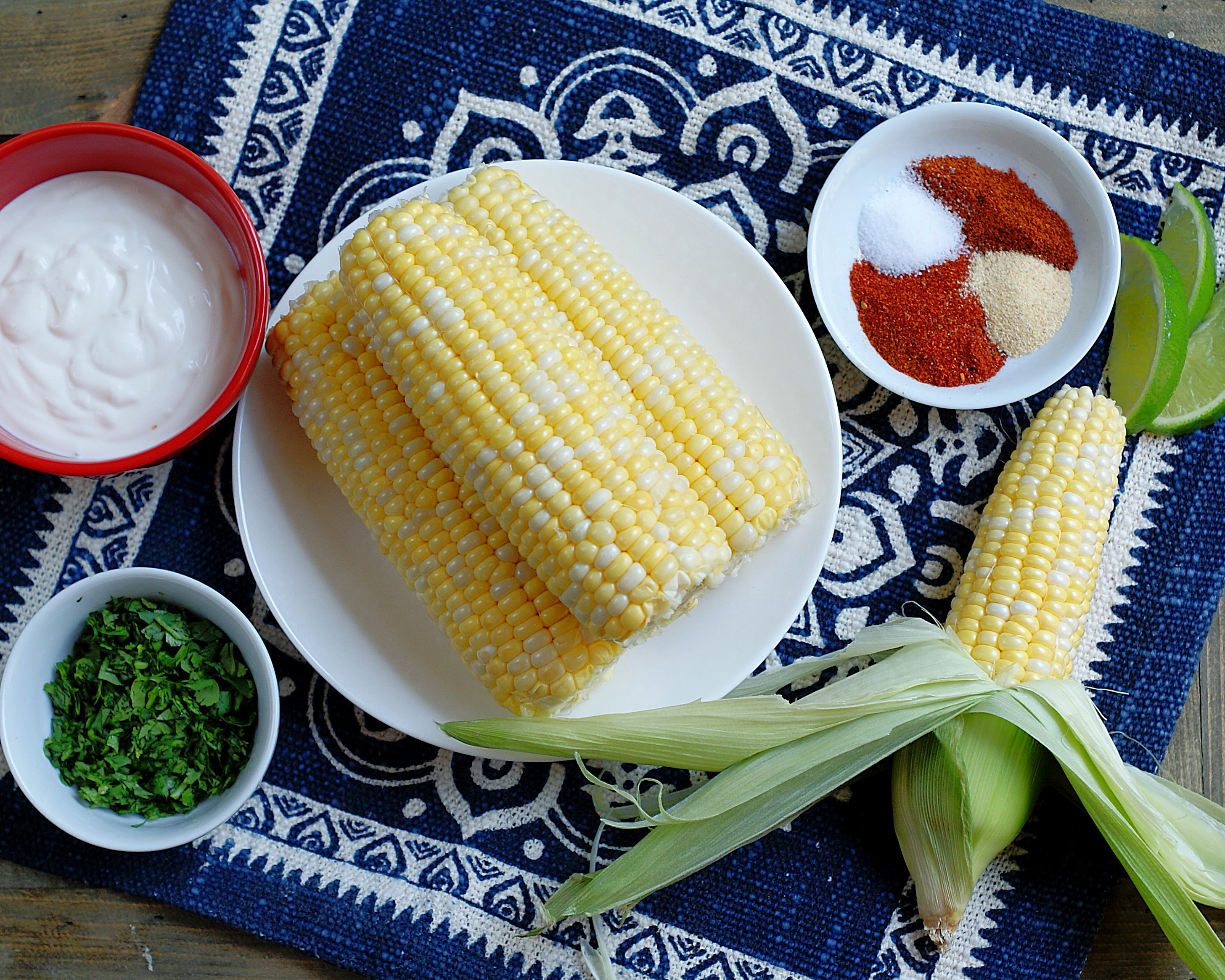 Cilantro, sour cream, mayonnaise and spices flavor Mexican Street Corn.