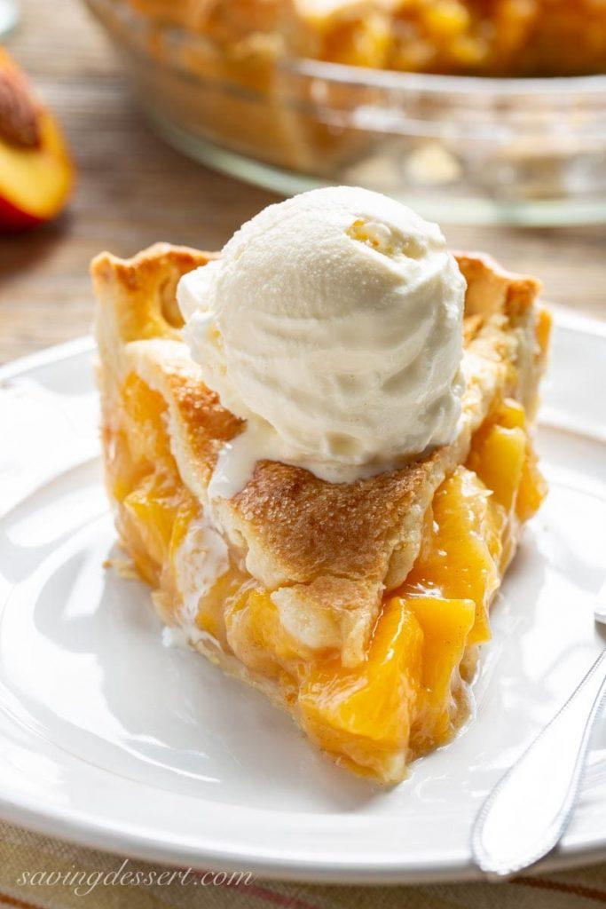 Fresh Peach Pie with vanilla ice cream on top.
