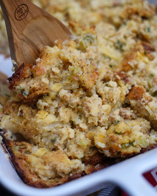 A pan of cornbread dressing with summer squash.