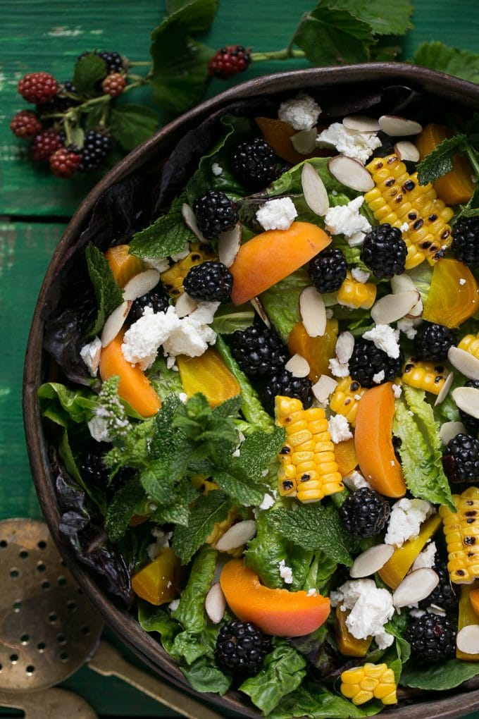 This blackberry salad is full of fresh berries, apricots, corn, feta cheese and almonds, all drizzled with a creamy apricot dressing.