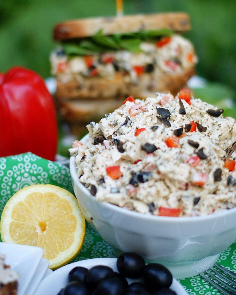 A bowl of chicken salad and a chicken salad sandwich.