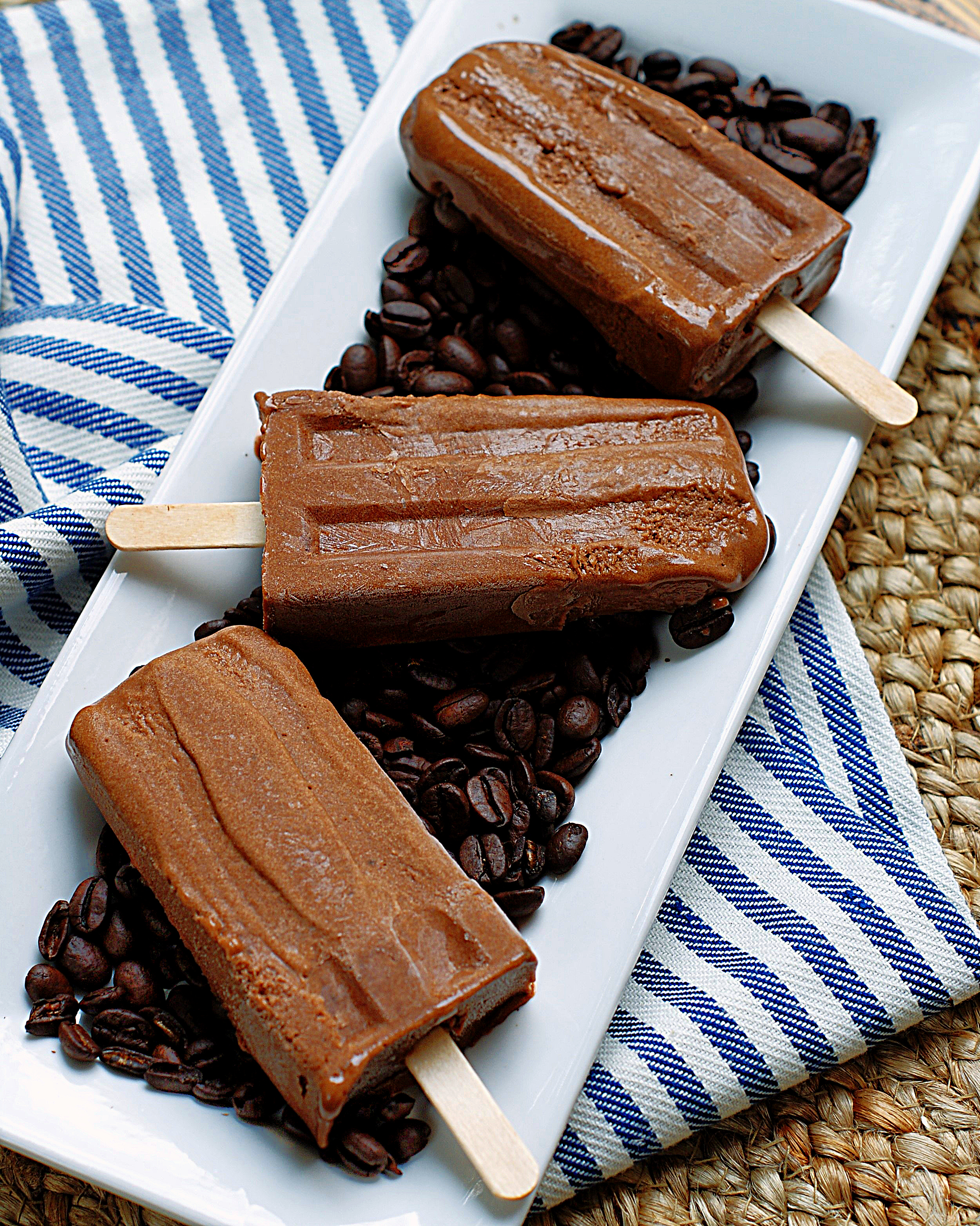 3 mocha fudgesicles on coffee beans