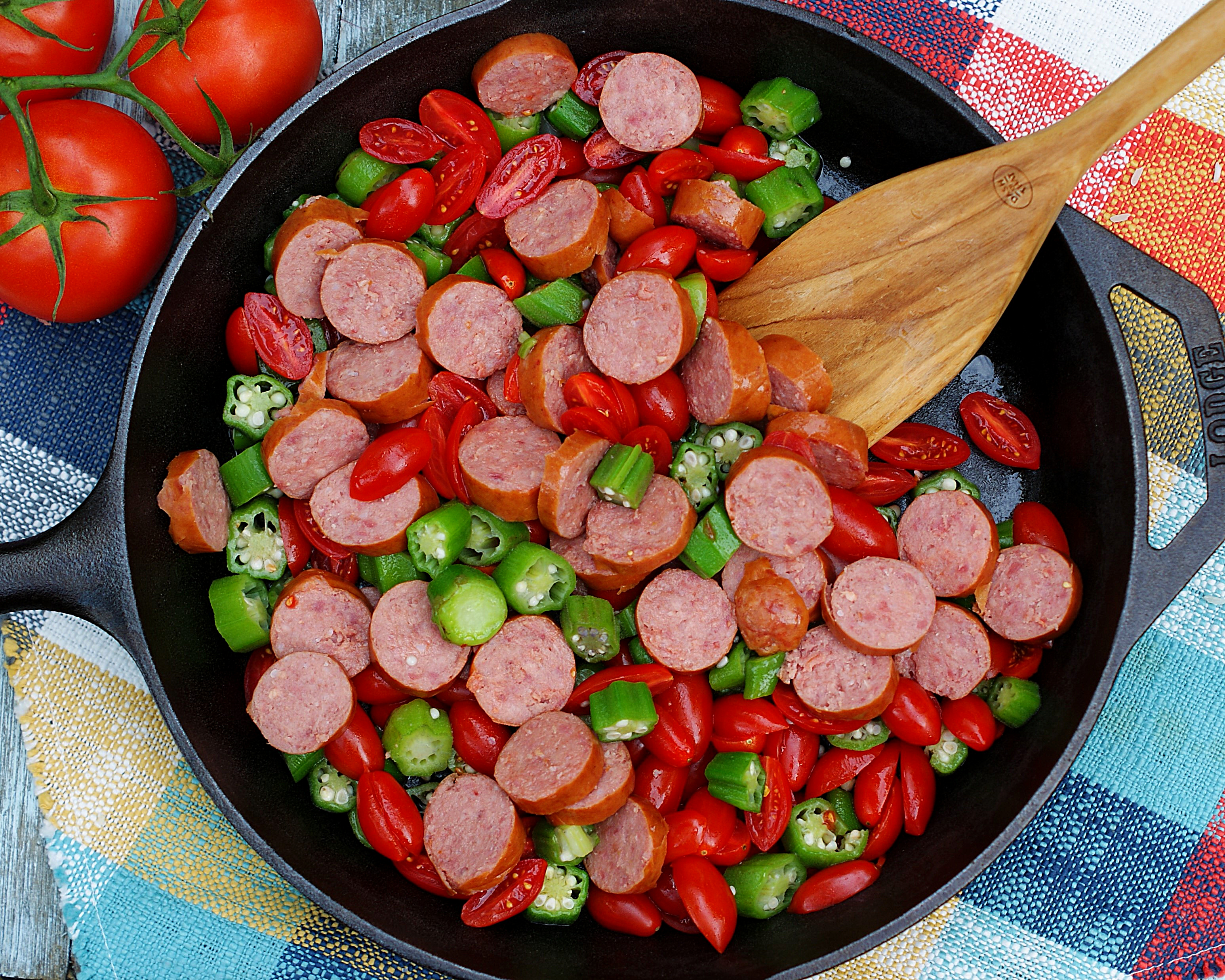 Tomatoes, Okra and smoked sausage in a skillet ready to sautee.