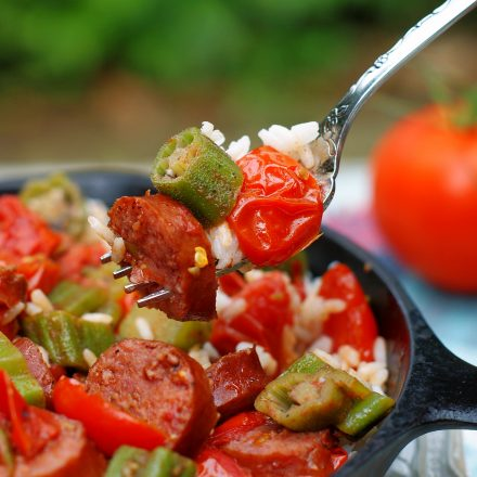 A forkful of Okra & Tomatoes with sausage.