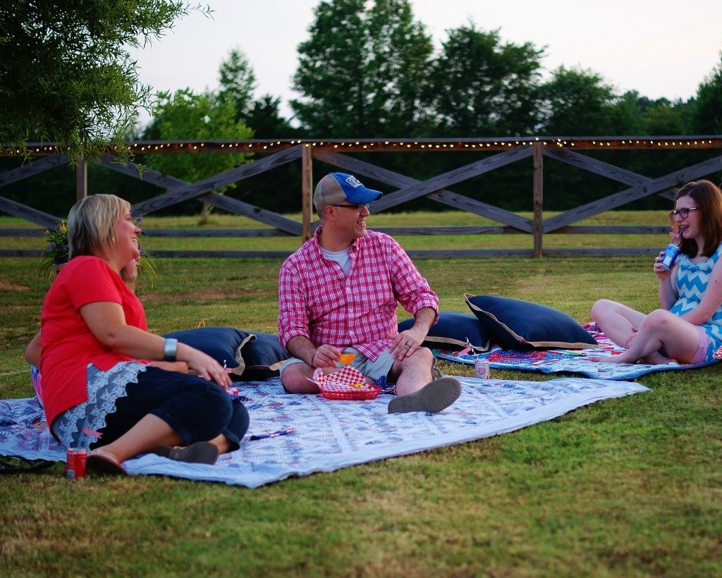 3 people enjoying a picnic
