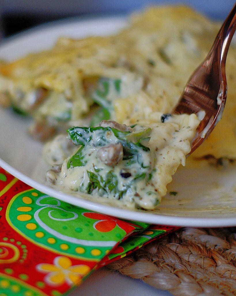 A forkful of white ravioli casserole