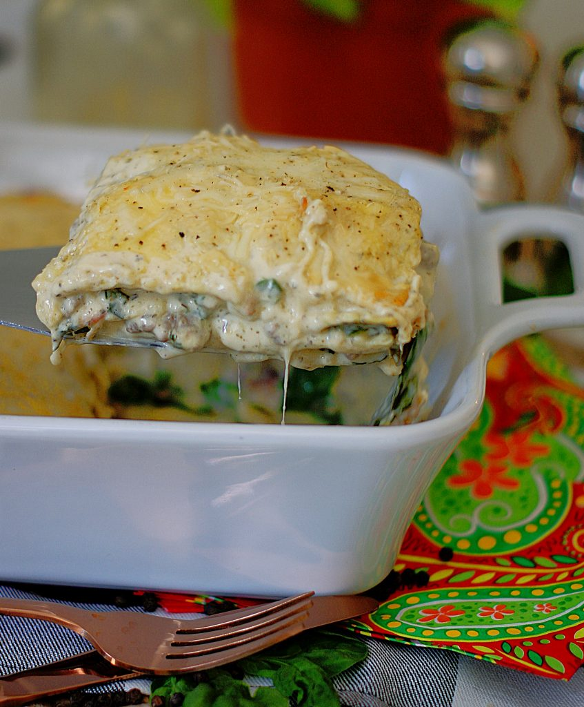 A serving of easy ravioli casserole being pulled from the pan.