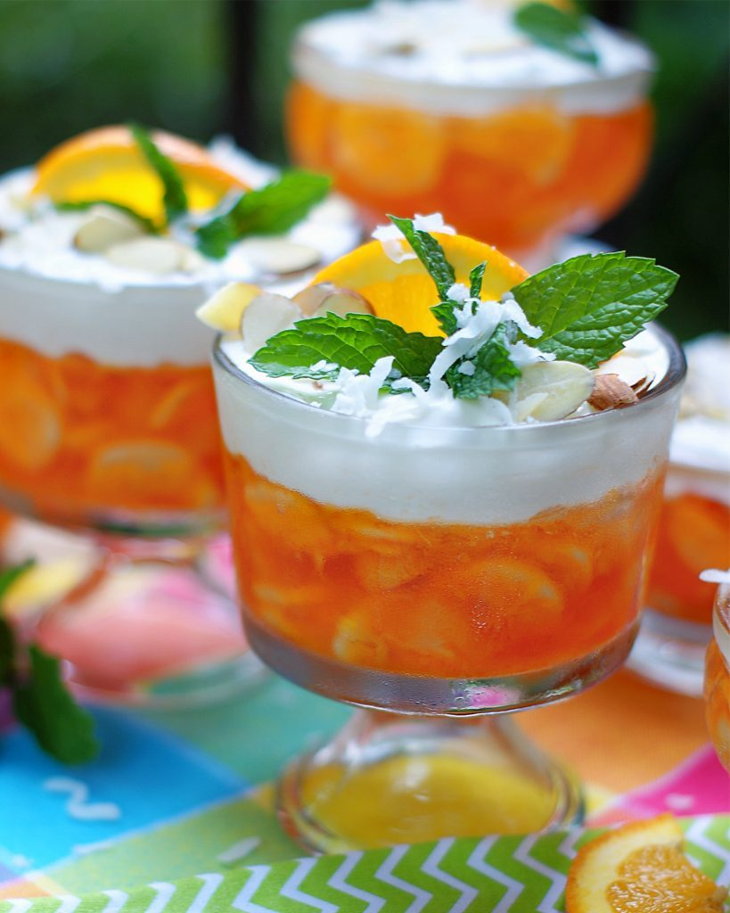 An individual dessert bowl of orange jello salad