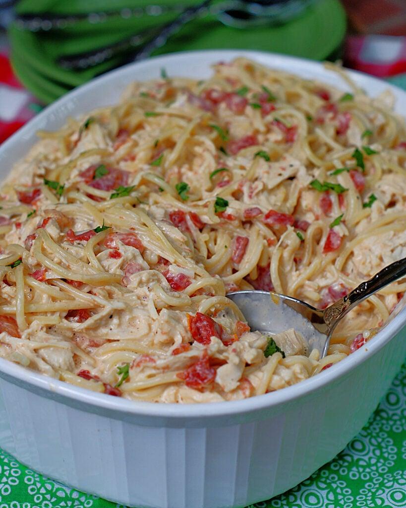 A casserole dish full of Rotel Chicken & Spaghetti
