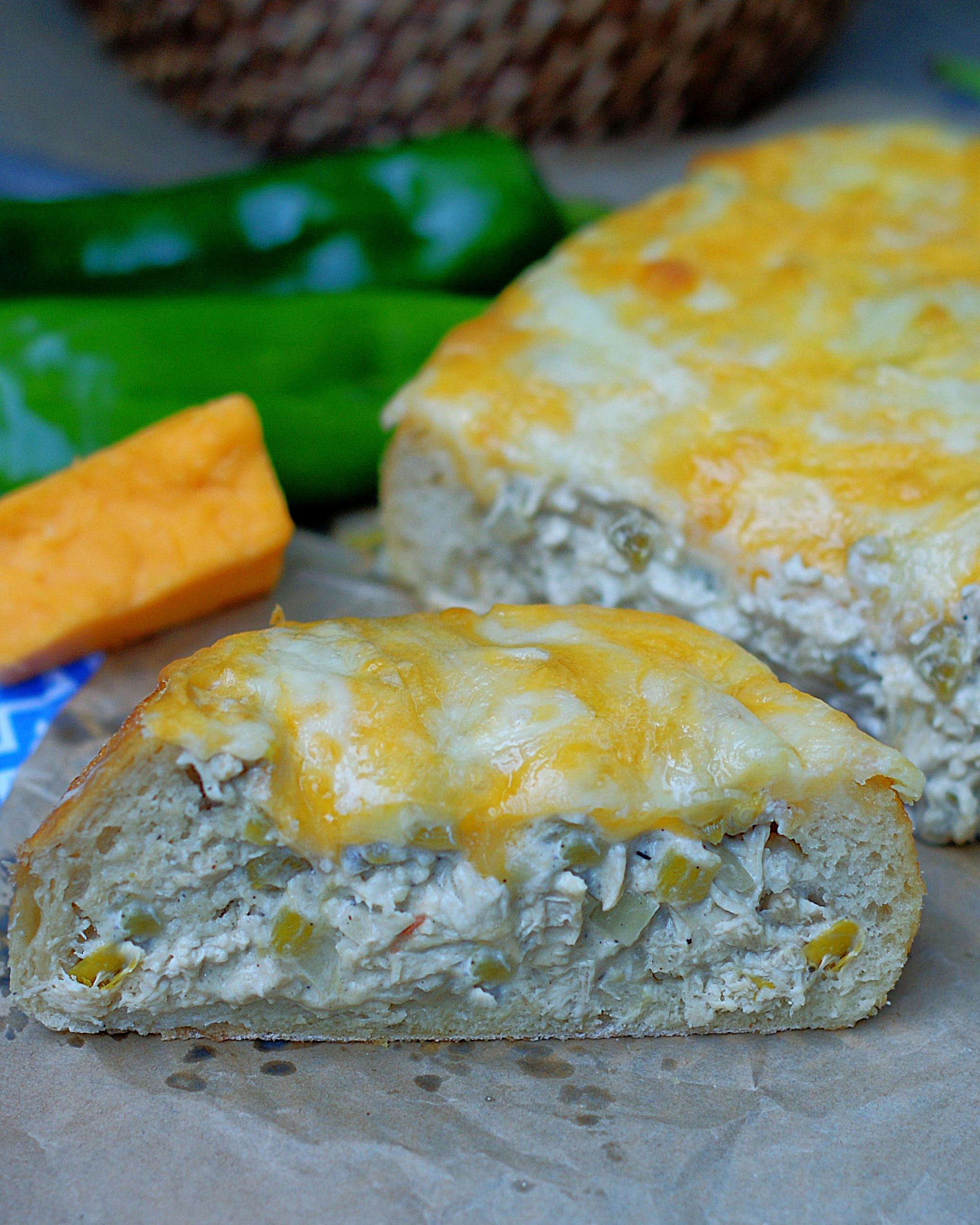 A loaf of Green Chile Chicken Stuffed Bread cut in half.