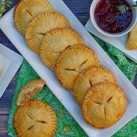 Sausage & Cream Cheese Handpies ready to serve on a platter