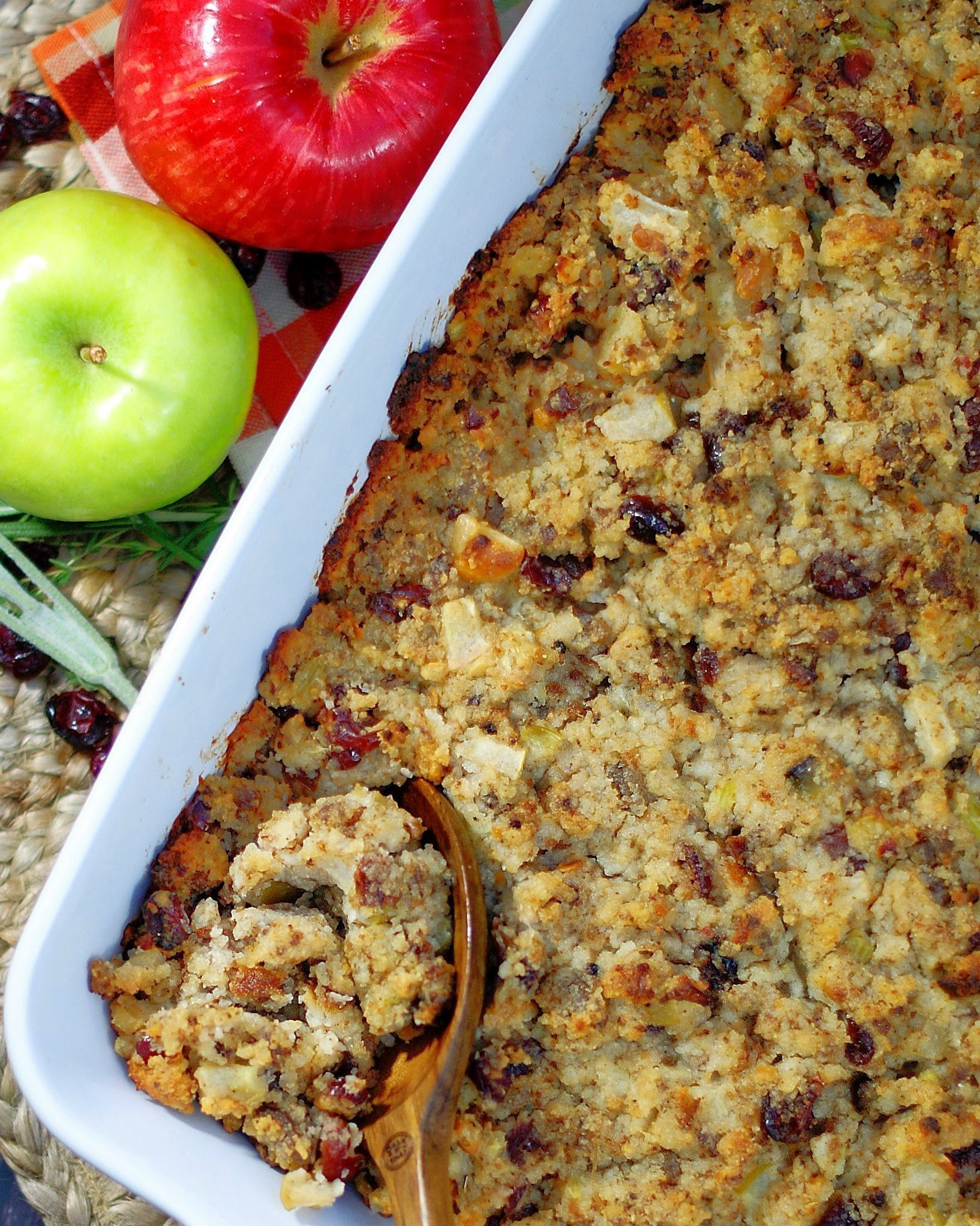 Sausage Apple Cranberry Dressing overhead photo with wooden spoon