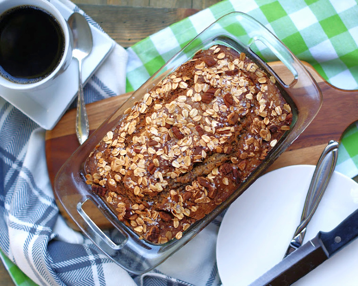 A baked loaf of banana bread in the pan.