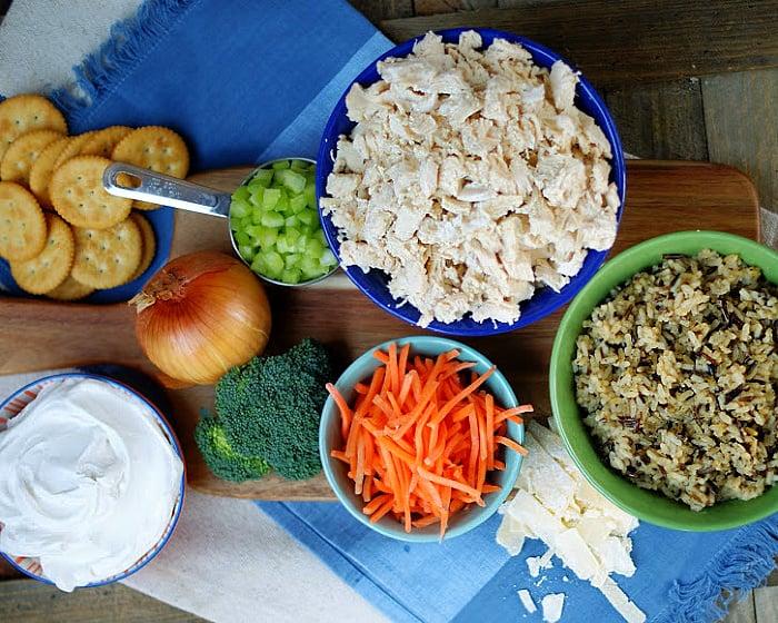 The ingredients to make Chicken & Wild Rice Casserole in a skillet.