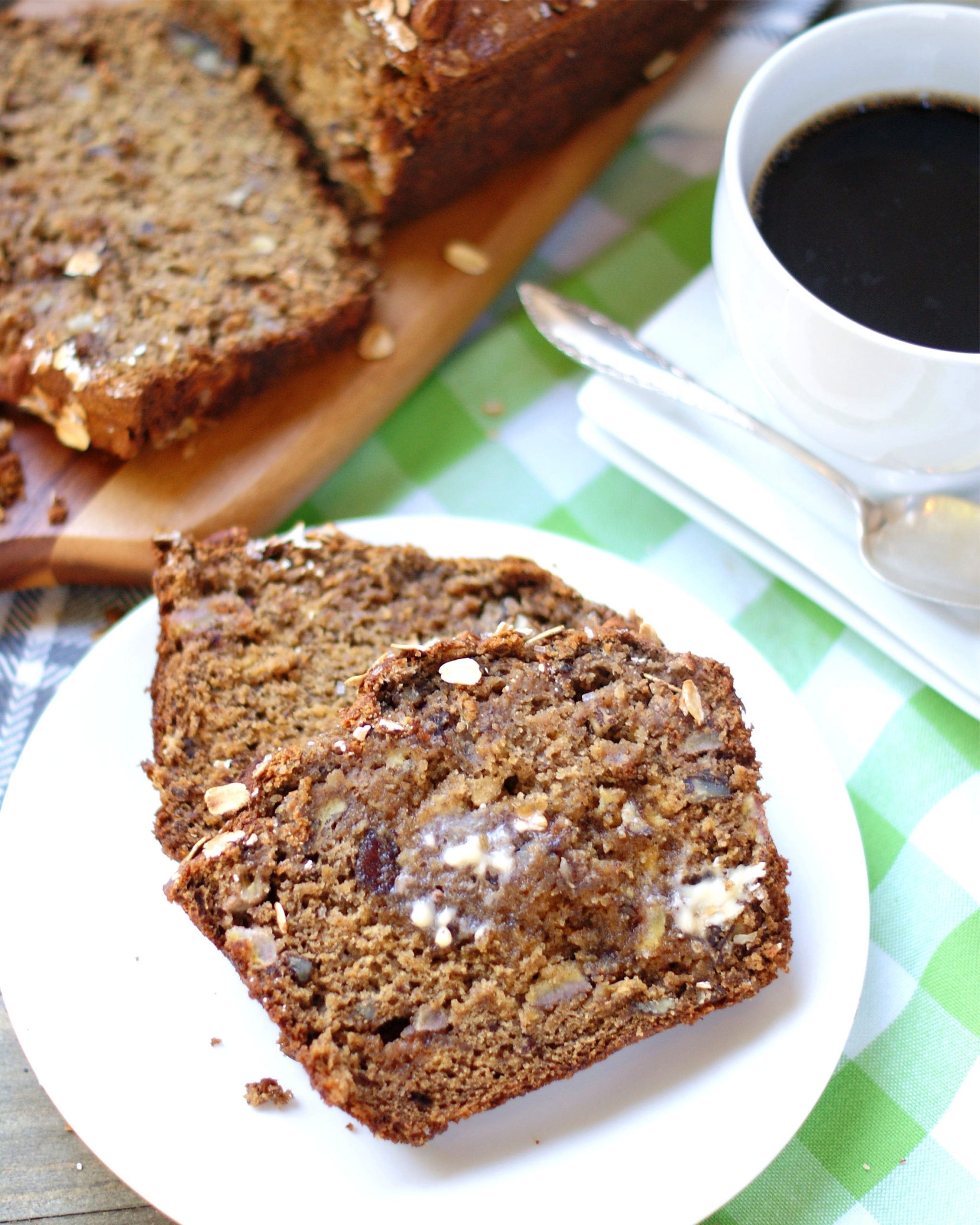 A slice of cinnamon banana bread with butter
