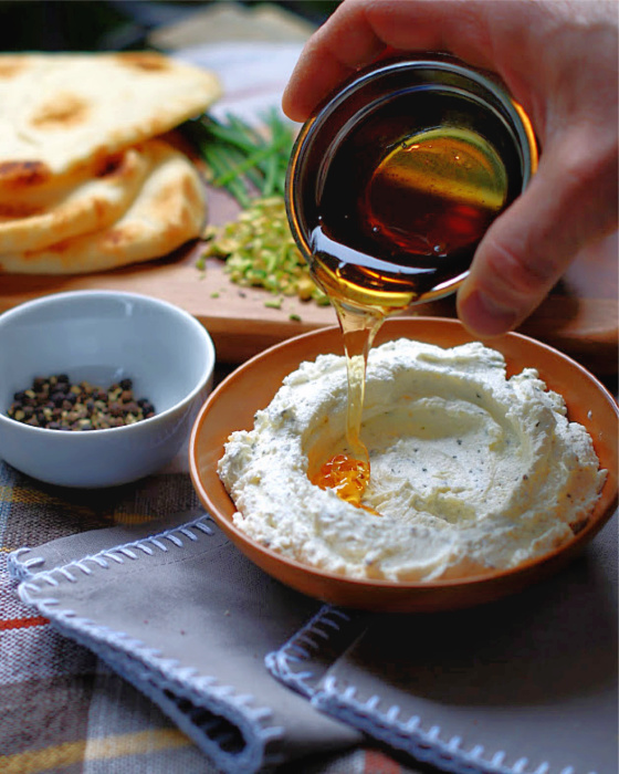 Drizzling the honey over whipped feta dip