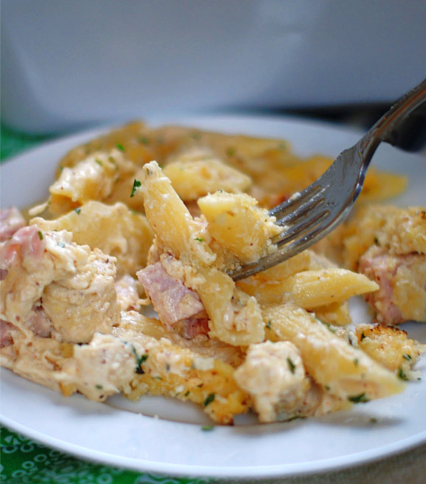 Chicken Cordon Bleu Pasta Casserole on a fork.
