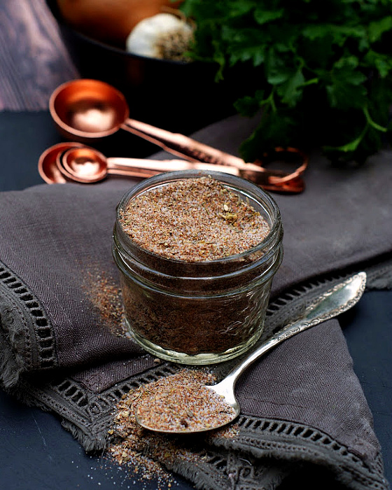 A jar and spoon of creole seasoning