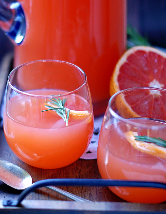 A cup of Ruby Grapefruit Punch with garnish