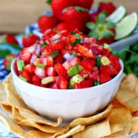 A bowl of spicy & sweet strawberry salsa dip