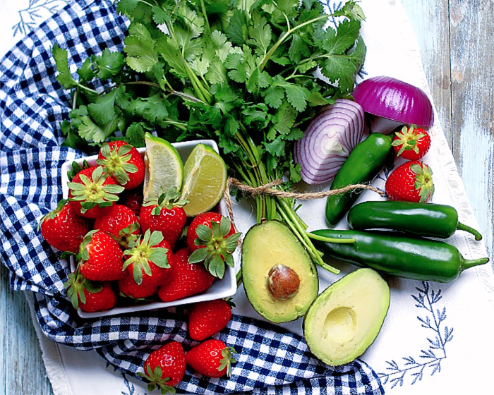 The ingredients for a fresh strawberry avocado salsa recipe
