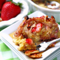 Strawberry French Toast Casserole on a white plate with a fork.