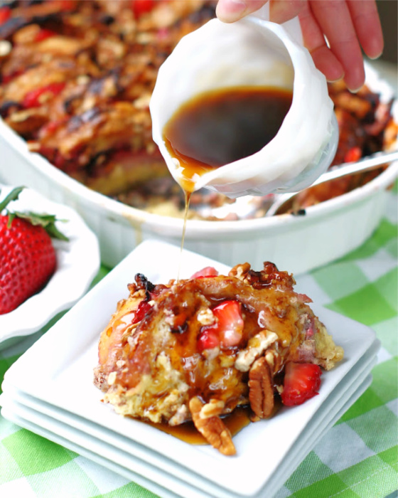 Breakfast Strawberry French Toast Casserole on a plate with syrup.