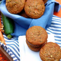 A basket of healthy carrot zucchini muffins ofr breakfast or snack.
