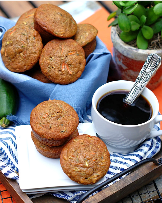 A basket of Carrot Zucchini Muffins with Walnuts and a cup of coffee