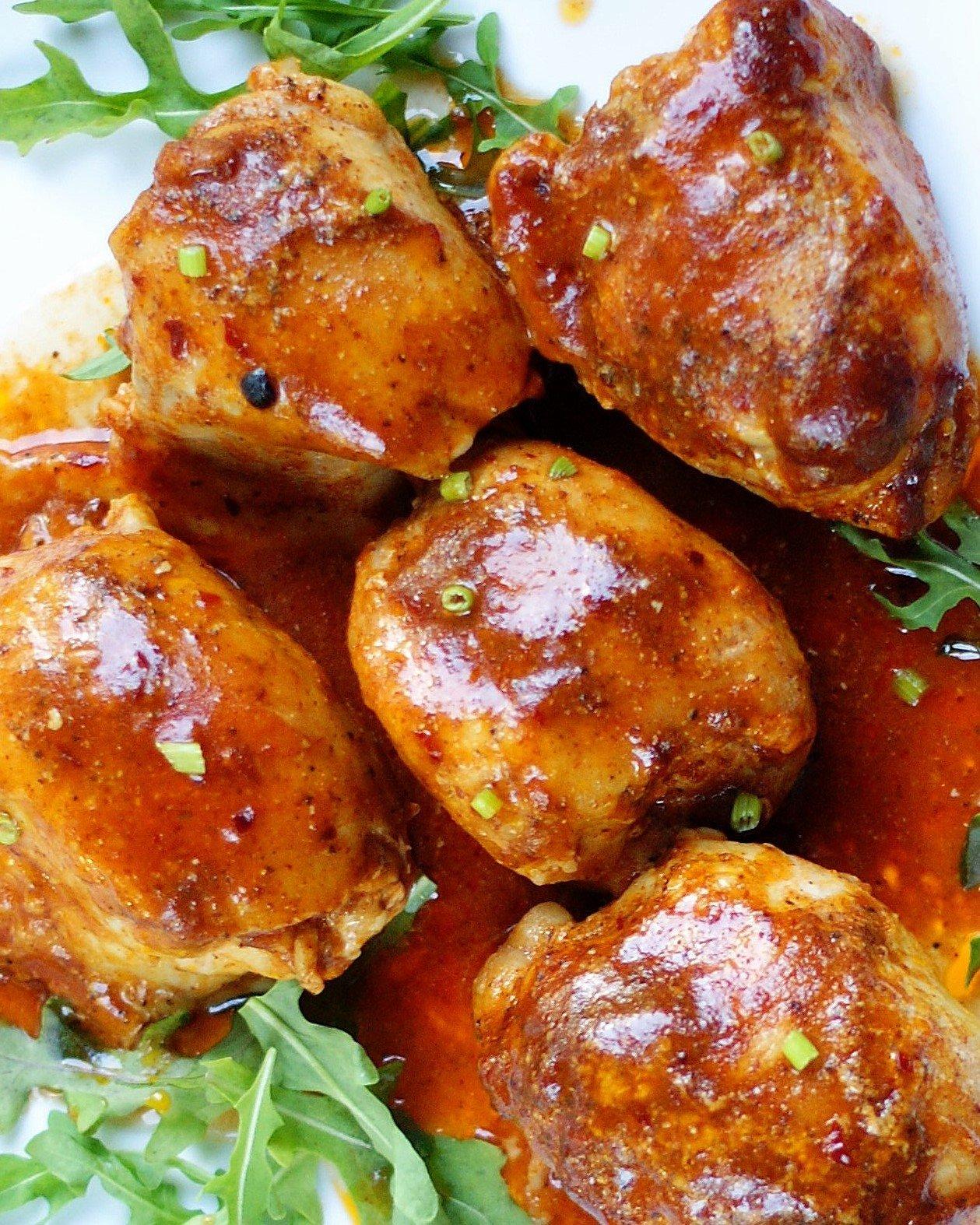 close up of crock pot BBQ boneless skinless chicken thighs