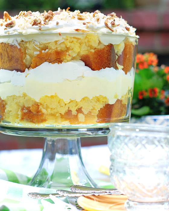Easy Coconut Pineapple trifle dessert recipe with crushed pineapple, yellow cake, cream cheese, vanilla pudding & whipped topping.