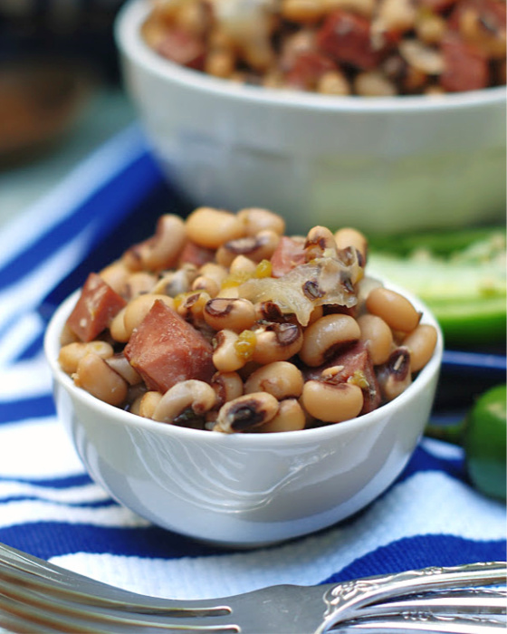 Slow Cooker Black Eyed Peas in white bowl with forks