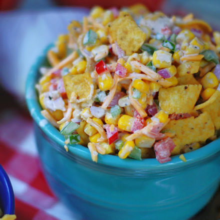 Potluck Frito Corn Salad in blue bowl