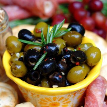 Easy Italian Marinated Olives in yellow bowl