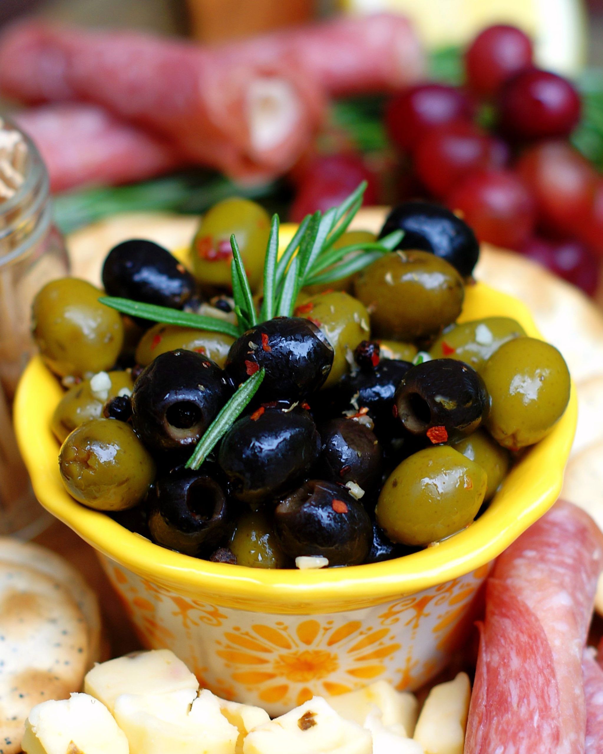 Easy Italian Marinated Olives in yellow bowl