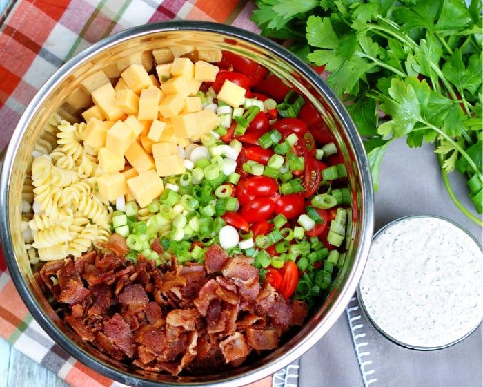 Making Bacon Tomato Pasta Salad