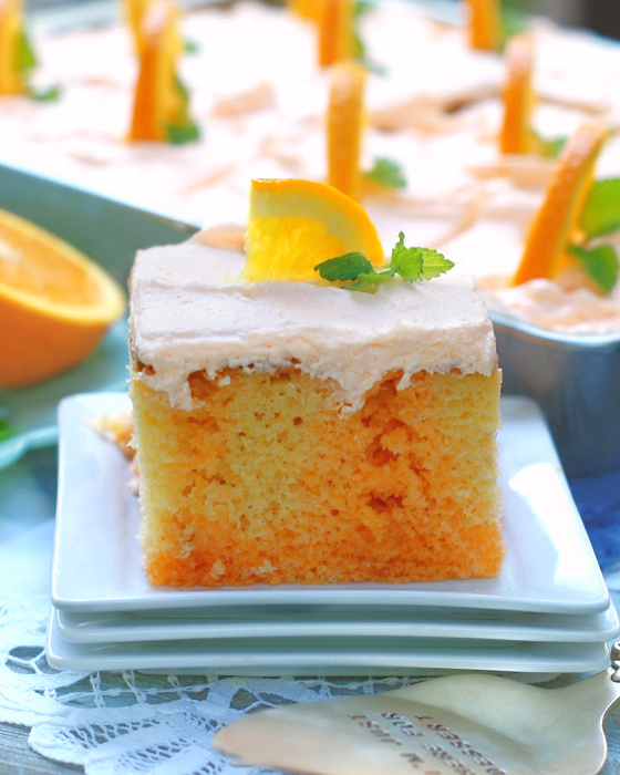 Slice of Best Orange Creamsicle Poke Cake