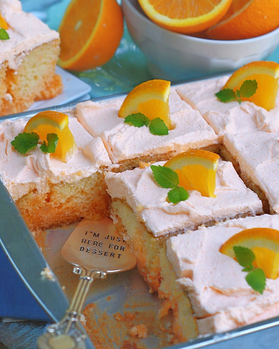Best Orange Creamsicle Poke Cake in a sheet pan