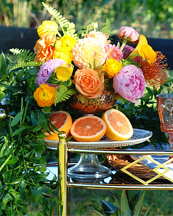 Add a bouquet when styling a bar cart for a party