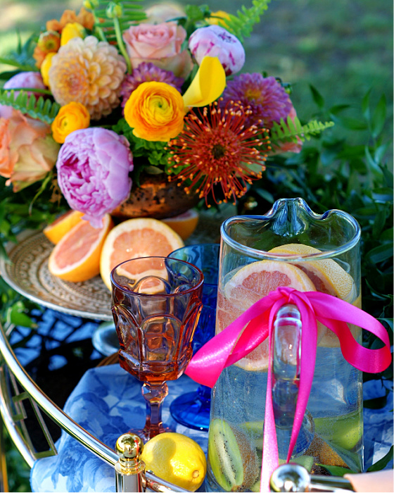 Glasses & Drink Pitchers with ribbon finalize bar cart styling.